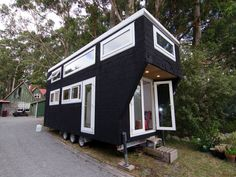 Matt Bain and his partner Jodie Williams spent last year building a humble abode measuring just 7m long by 2.5m wide. - New Zealand Herald
