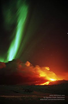 Northern lights also known as Aurora borealis and a volcanic eruption in mount Hekla in 1991, there is a plane that flew in front of the ash plume and left a line in the photo. The constellation Leo is in the background.