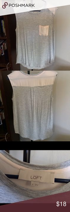 NWOT Size M LOFT Gray tank This LOFT tank is brand new without tags. It's a light grey with a light Link front pocket and shoulder detail. LOFT Tops Tank Tops