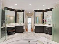 Bathroom layout with dual hair and make-up vanity private toilet, glass shower and center tub. Contemporary Bathrooms from Drury Design on HGTV