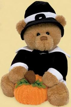 Gund Blake Pilgrim Teddy Bear with Pumpkin  Blake is wearing a black Pilgrim's coat with white collar and cuffs.  On his head is a black hat with white band and black buckle. Blake is holding a pumpkin between his paws. safe for all ages 6 1/2 inches