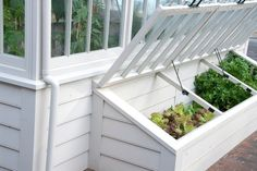 Cold frame for veggies -- recycle old windows.  I like how this one fits in with the architecture of the house and sits against it.