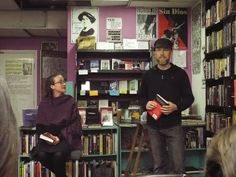 Cooperative Wooden Shoe Books and Records volunteer Matthew Dineen and Hillary Klien