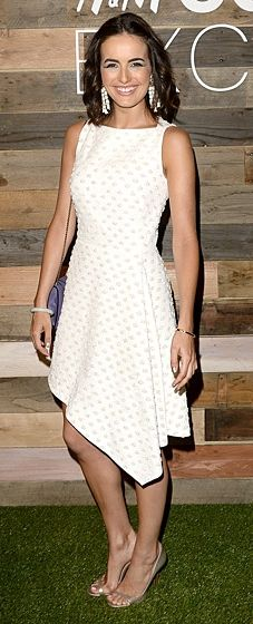 Camilla Belle wears an Osman dress and H&M Conscious Collection earrings to the H&M Conscious Dinner