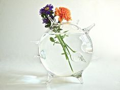 glass globe with flowers | love that this vase looks like a little glass pufferfish.