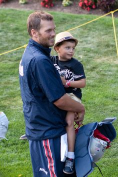 with his son, Benjamin, after training camp (8/11/14)