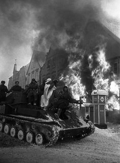 Soviet troops roll into the German city of Mulhausen. March, 1945.  Arkady Shaikhet
