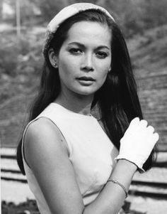 Nancy Kwan in the 1966 film Arrivederci, Baby!   More hair inspiration to get that perfect doo. Nancy shows us styles that work for both long and short hair.