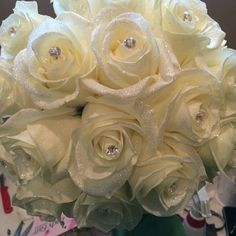 Wedding bouquet of white roses, diamond crystals and diamond dust