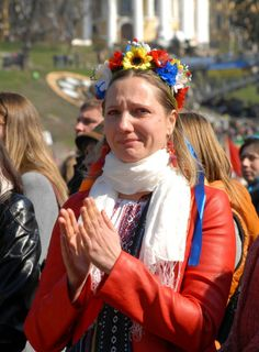 Ukrainian woman cries at the 40th day memorial service for demonstrators killed in Kyiv
