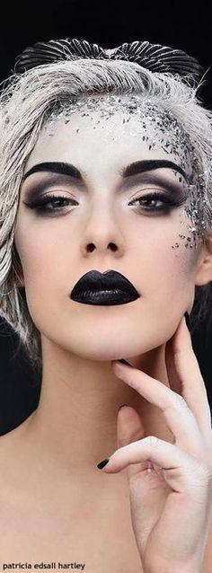 Stunning futuristic, cyborg-like makeup + hair. x
