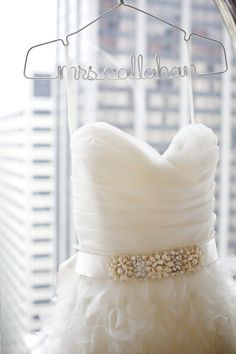 so cute, your new last name on the hanger for your wedding dress <3