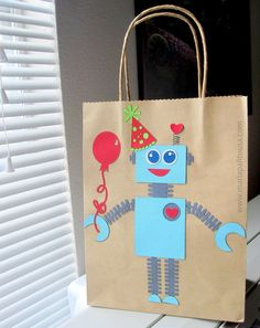 ROBOT Party Favor Bag  Do with the plain robot printable. Add balloon & party hat. Same kids' names on body