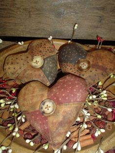 Prim Bowl of...old stained & quilted stuffed hearts...with buttons.