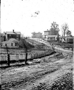 1864 view of houses along South Collins Street in Atlanta. This area of South Collins was later renamed Washington Street and was eventually destroyed to make way for the Downtown Connector.