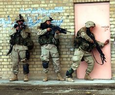 US Army soldiers belonging to T-F 2-7 CAV prepare to enter a building during the 2nd Battle of Fallujah, Iraq, Nov-Dec 2004. The battle is considered the highest point of the conflict in Iraq and, according to the US Marines, Fallujah involved the marines in the heaviest street fighting since the Battle of Hue in Vietnam, 1968. 2nd Fallujah was the bloodiest engagement of the war and it fought exclusively against insurgent forces.