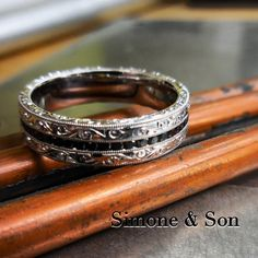 Our custom men's bands can be just as stunning as our women's bands. Check out this masterpiece! #weddings #diamonds #engraving #weddingrings #orangecounty