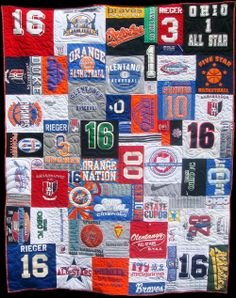 Kent's Auntie Shawn makes awesome quilts out of old t-shirts!  I have a pile of shirts from my Flora teaching days that I can't wait for her to put together!