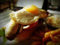 dressed up hot dog with sunny side up egg !