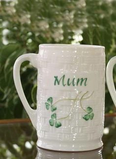 Belleek Fine Parian China basket weave design embellishes this personalized 'Mum' mug. Decorated with a hand painted Irish Shamrock emblem and in green letters the word 'Mum'. An ideal gift from Ireland for your Mum on her birthday or Mother's Day that will make her day. A thoughtful present which will hopefully bring the luck of the Irish. US$29.00 || Belleek Mum Mug ||