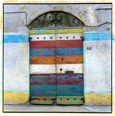 Striped door. Italy