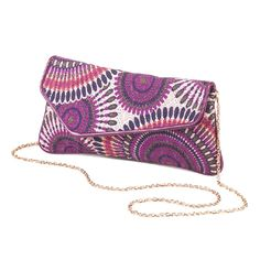 The colorful embroidery on this asymmetrical clutch and shimmering detachable gold chain make it perfect for daytime use and those special evening occasions. Fabric pattern on actual product may vary. A gorgeous finishing touch for your prettiest outfit! #clutchpurse #asymmetricalclutch #fashionaccessory