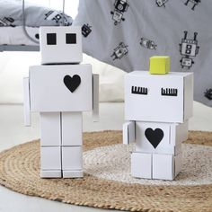 We are the ooh noo robots. We come with black foil which you can cut out any way you wish and use to decorate us to your heart's content. As you can see, we're all ready for Valentine's Day...❤! www.ooh-noo.com