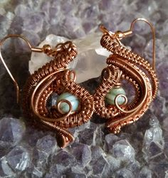Wire wrapped Copper Earrings with 6 mm round Light Green Glass Beads