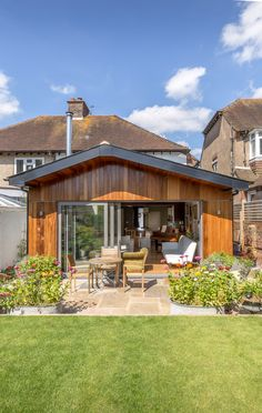 Contemporary pitched roof rear extension | terrace property | cedar clad finish | timber cladding | roof overhang | modern architecture | open plan living | Hove | Brighton Architects | Sussex