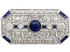 A stunning, fine and impressive vintage (circa 1970) 4.05 carat blue sapphire and 4.05 carat antique (circa 1910) diamond, platinum brooch in the Art Deco style; part of our diverse vintage jewellery and estate jewelry collections