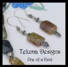 http://www.sellergroup.com/shop/TelumaDesigns  Exotic Earrings of faceted Dust Agate Gemstones with Sterling Silver. Soft caramel brown with a touch of greenish yellow. Matching Necklace. OOAK handmade in Australia (Code 330E)