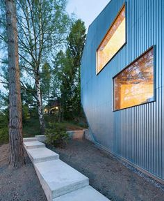 contemporary country home with plywood interior design and galvanized metal house exterior