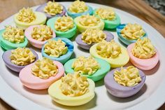 To make multi-colored deviled eggs:  Fill glass containers about half-full of water, and then add food coloring (I wonder if you could use natural food dyes?) to each one to get the shades you desire.  Place the cooked egg halves (yolks removed) in the water, making sure that the entire surface of each egg is covered and let the eggs sit at least one hour until you achieve the desired effect. Remove and dry the eggs and fill as you normally would.