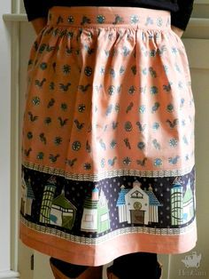 Peaceful barns and mid-century crazy chickens on this vintage apron!