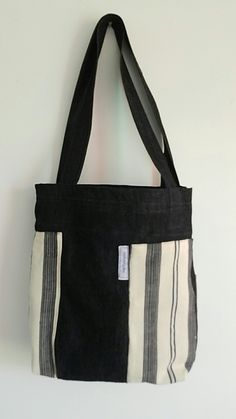 """Le #sacdumarche chez #nattyworks the #marketbag black #denim and 100% #cotton imported from #guinea #conakry, synthetic interior lining with denim pocket and #velcro enclosure; 13"""" wide by 14"""" high."""