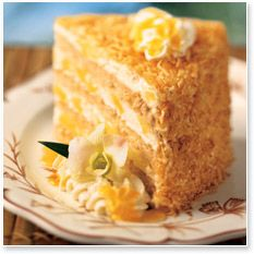 PIÑA COLADA CAKE  Serves 8     Ingredients:  1 1/2 lbs. Pillsbury® white cake mix  14 1/2 oz. water  2 eggs  2 oz. canola oil  3 1/4 lbs. Piña Colada White Chocolate Mousse (see recipe below)  24 oz. Toasted Coconut (see recipe below)  24 oz. crushed pineapple tidbits  Myers Dark Rum in a spray bottle (see assembly instructions below)
