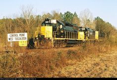 "Alabama Southern Railroad   Description:  Westbound ABS ""Artesia train"" shown here nearly at Coker, Ala. where the new yard limit is set (GM&O mp 68).   Photo Date:  2/15/2009 Location:  Northport, AL   Author:  Rick D  Categories:    Locomotives:  WAMX 4118(SD40-2) WAMX 3899(SD38-2)"