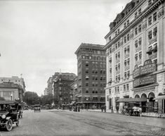 """High-Class Vaudeville: June 1915. Washington, D.C. """"Fifteenth Street north from G Street N.W."""" Starring the Keith's Theater building, whose corner bar is now the address of the Old Ebbitt Grill. 8x10 inch glass negative, National Photo Co."""