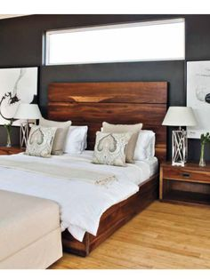 Neutral bedroom  beautiful wood headboard. The cushions make it.