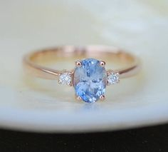 Blue sapphire engagement ring. Promise ring. Oval engagement ring. 3 stone ring. Rose gold engagement ring. Gemstone ring by Eidelprecious by EidelMini on Etsy https://www.etsy.com/listing/532352855/blue-sapphire-engagement-ring-promise