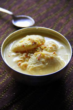 Rasmalai:  Best recipe with tons of pictures for each step included...will try for sure!!  (Sweetened Paneer in Milk Cream).