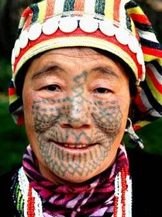 Jiasong of the Derung ethnic group shows her tattooed face in Drung-Nu Autonomous County of Gongshan, southwest China's Yunnan Province