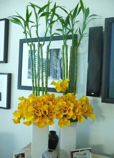 2012 color trend floral arrangement using yellow calla lilies and bamboo, from Le Petit Gardenia