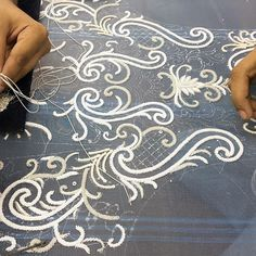 Making an embellished bridal gown involves a lot of #teamwork ... Here, Raju and…