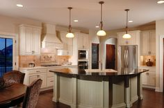 Design 42057 Kitchen. As built by Sam Bradley Homes in Springfield, MO.
