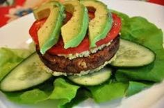 Atkins diet food  100 gram hamburger patty 0.5 avocado 1 tomato 50 gram mixed salad leaves  Grill the burger and then slice the avocado and tomato and top the burger with them. Serve in a romaine leaf with mixed salad leaves.