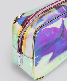 Iridescent toiletry bag, - Transparent toiletry bag with an iridescent design. Measurements 17 x 23 x 9 - Find more trends in women fashion at Oysho . X 23, Unicorn Rooms, Unicorn Makeup, Macbook Case, Cute Little Things, Cosmetic Pouch, Toiletry Bag, Sport, Transparent