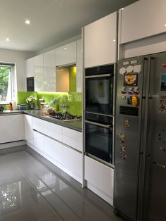 Mill Hill NW7 Handle-less white gloss teamed up with 30mm Grey Quartz Worktops and Lime Green glass splash backs