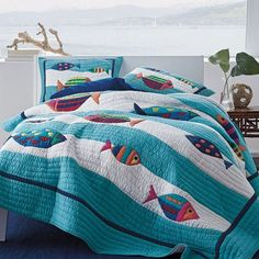 Oceana Quilt / Sham - A lighthearted quilt for beach house or summer cottage, this brilliant layer brings a splash of whimsy to the bed.