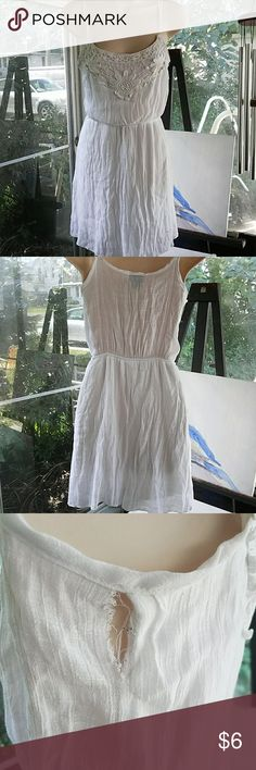 Rue 21 summer dress Adorable white dress. There is a small rip but it should be easy to sew! Rue 21 Dresses